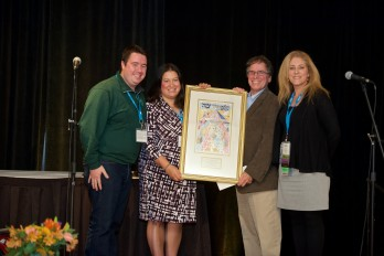 Jonah, Toni, Mitch Kupperman and Ruth Wallace pose for a photo with Camp Interlaken's award.